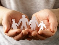 Hands holding family | PCRS | IRP